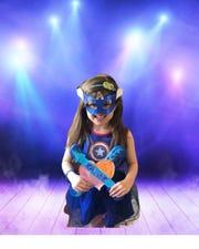 Kindergarten student, Hailey Jurista dressed as an ALT superhero