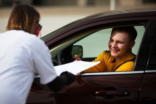 East High School seniors receive their EHS Alumni Foundation scholarships via drive-through on May 1, 2020. Each merit-based scholarship given out via drive-through ranges from $500 - $11,000 and is given to 88 graduating seniors.