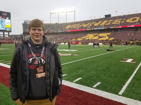 Davenport Assumption 2021 offensive lineman Tyler Maro poses during a visit to Minnesota.