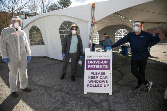 """Dr. Richard Keidan, left, poses with Mitch Albom and Marc """"Rosey"""" Rosenthal outside of Say Detroit that has opened a mobile/walk-up clinic COVID-19 testing site in Highland Park on May 1, 2020. The project, that allows people to walk up without a prescription for testing, was funded by the Human Touch serial book series by Mitch Albom."""