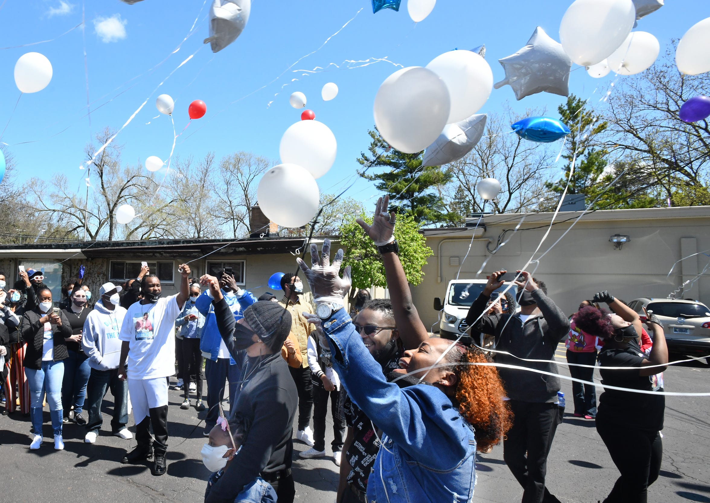 Lorenzo Seldon's family and friends let loose a sky full of balloons at a memorial service Friday at Fisher Funeral Home in Redford Township.
