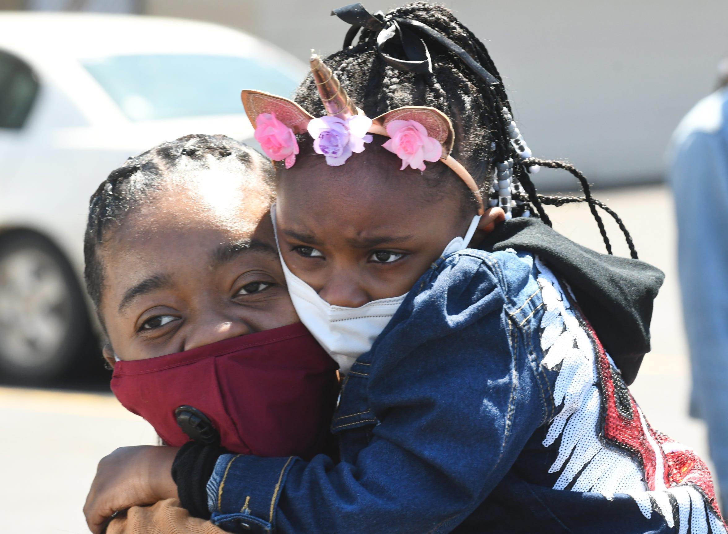 Illyse King hugs Lorenzo Seldon's granddaughter Aliyah Hooper, 5, during Friday's memorial service.