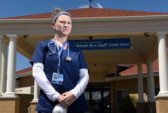Randie Contreras stands in front of the Bell Fountain Nursing Home and Rehabilitation facility in Riverview, Friday, May 1, 2020. Contreras will hit the ground running when she starts her new career as a registered nurse in two weeks in the Beaumont Dearborn emergency room, dealing with COVID-19 patients.