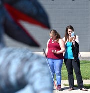 Cristan Riley, right, and her daughter, Elizabeth, both of Ferndale, watch the characters walk on Spencer.