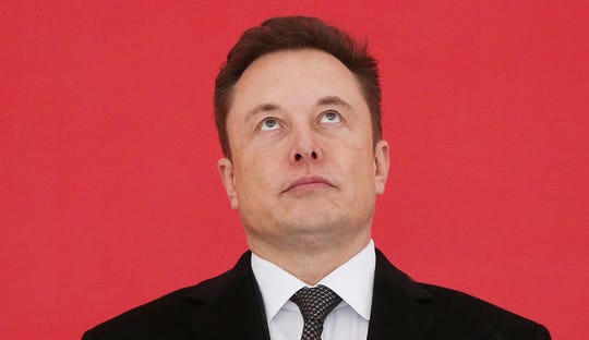 Tesla CEO Elon Musk attends the groundbreaking ceremony of Tesla Shanghai Gigafactory in Shanghai, east China in this Jan. 7, 2019, file photo. Musk is poised to meet the final performance threshold needed to claim the first piece of his moonshot pay package, options that would yield Musk a windfall of about $730 million if he exercised them immediately.