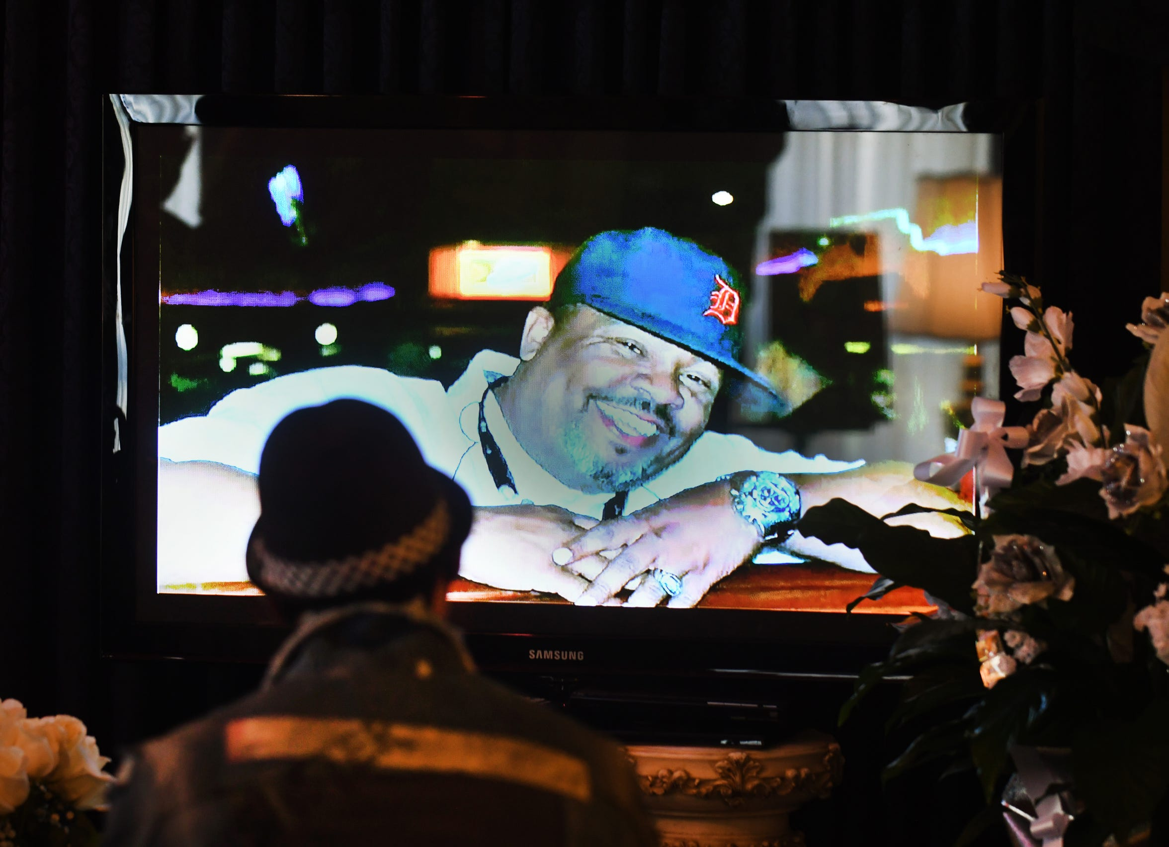 An image of Lorenzo Seldon, 51, a union steward at Fiat Chrysler's Warren Truck plant who passed away from COVID-19, is projected at his memorial service in Redford Township, Michigan on May 1, 2020.