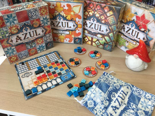 In Azul, players take turns drafting colored tiles from suppliers to their player board.