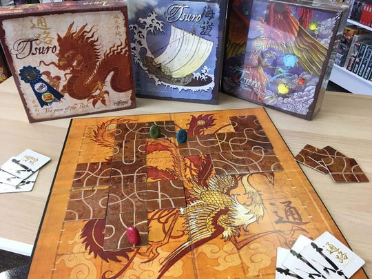 In Tsuro, player try to manage the paths laid out for the markers, in an effort to keep them from falling off the side of the board.