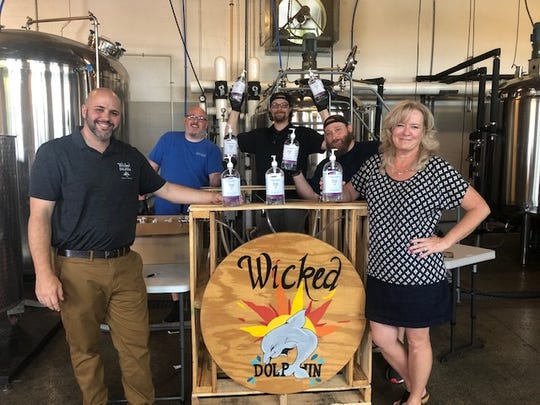 Wicked Dolphin Distillery partners with Florida Crystals and Fort Myers Brewery to produce sanitizers for free giveaway on Saturday, May 2, 2020.