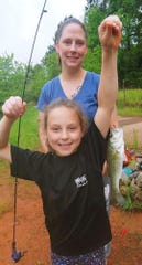 Zoe Kiraly shows off her first bass, which she caught at a Greenville County pond on April 23.