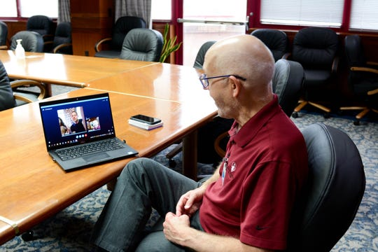Dr. Pete Stasikelis of Shriners Hospital for Children holds telehealth visit with Luther Chadwick, whose daughter Haley is a patient.