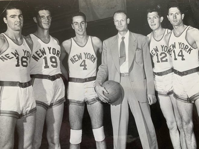 The 1947-48 New York Knickerbockers, from left to right: Bud Palmer (16), Lee Knorek (19), Carl Braun (4), head coach Joe Lapchick, Ray Kuka (12), and Tommy Byrnes (14). Braun and Kuka were rookies, the remaining three second-year players for the BAA (now NBA) team that finished second in the Eastern Division at 26-22.