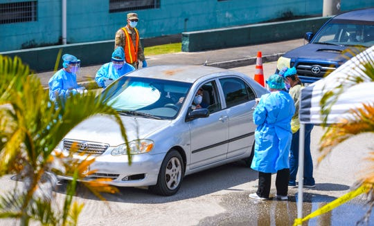 Department of Public Health and Social Services nurses pre-screen and process residents attending a drive-through/walk-in community test for the coronavirus, or COVID-19, conducted near the Agat Senior Center on Friday, May 1, 2020.