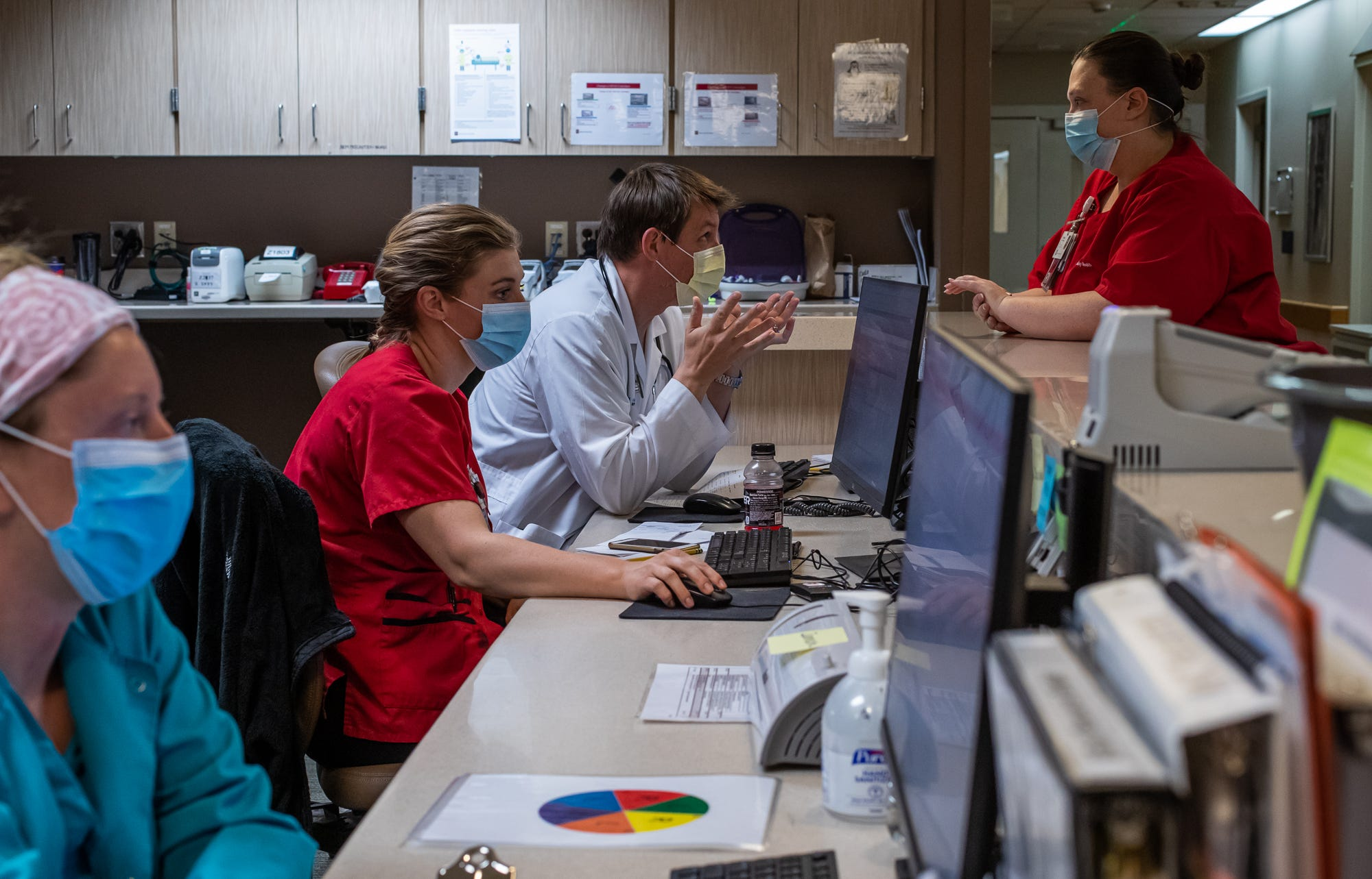 A doctor and nurse talk inside a COVID-19 unit at IU Health Methodist in Indianapolis on Thursday, April 30, 2020.