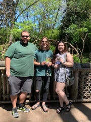 Karns High School Choral Director Seth Alvin Tinsley with All State singers Lee Pinkston and Sydni Stinnett at Nashville Zoo, April 13, 2019.