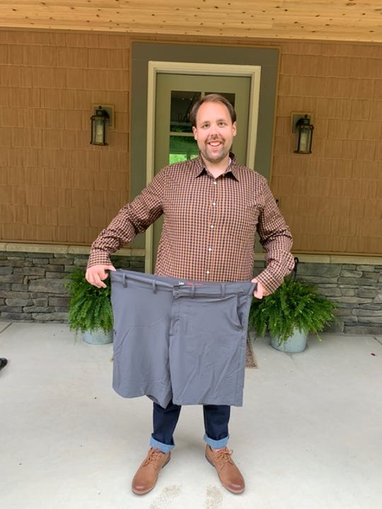 Karns High School Choral Director Seth Alvin Tinsley, outside his home in Karns, shows off his weight loss from behind a pair of shorts now much too large. April 29, 2020.