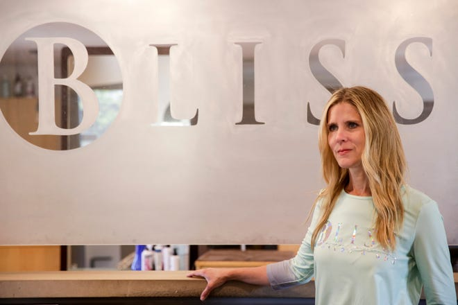 Bethany Tyrrell, owner of Bliss Salon and Spa, stands inside her salon, Friday, May 1, 2020 in Lafayette.