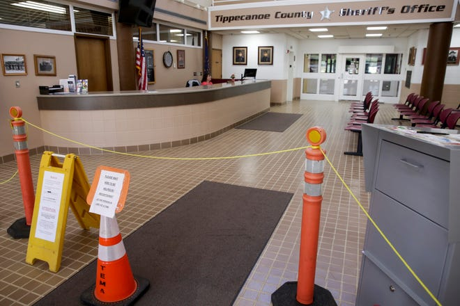 Signs posted in the lobby to the Tippecanoe County Sheriff's Office advise visitors of the changes to the building during the COVID-19 pandemic, Friday, May 1, 2020 in Lafayette.
