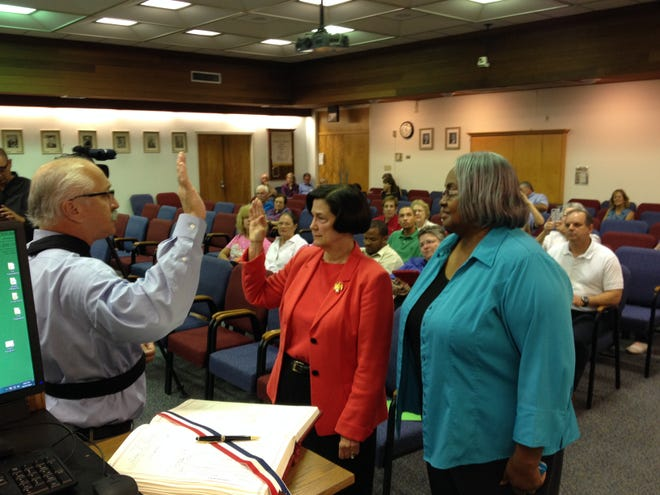 Melinda Mangham, center, takes the oath of office from Clerk of Court Louis Perret at the Lafayette Parish School Board meeting on Oct. 27, 2014. The board appointed Mangham to serve as the District 7 representative until Dec. 31, 2014.