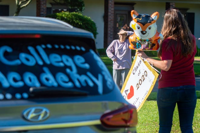 """ECA Senior Layla Parboo is surprised by teachers. The Early College Academy administrators, teachers and school board members drive to seniors' homes and surprise them with """"drive-by"""" celebrations. Friday, May 1, 2020."""