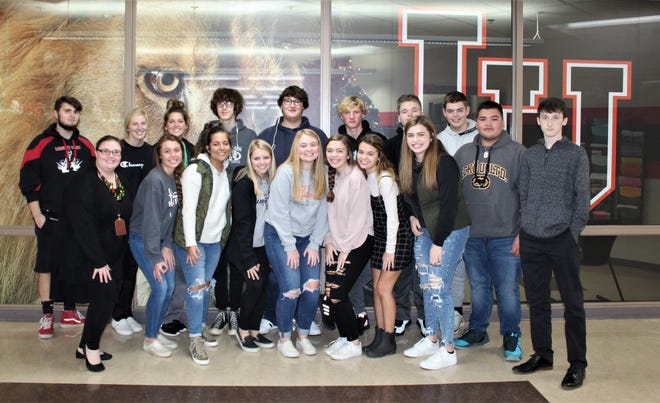 Liberty Union High School yearbook staff, with advisor Jamie Neal front left, poses for a group photo during the school year.  The staff, along with other yearbook student staff across the county, are adapting to the stay at home order.