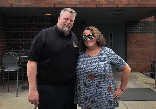 Detroit Police officer Ethan Grant and wife Lisa of Webberville pictured in a courtesy photo.  Ethan is at Sparrow Hospital fighting COVID-19, while Lisa fights the coronavirus at home.