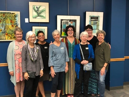 """Eight of the 11 member """"Lino Ladies"""" pose for a photo in 2019, from left,  Rosemary Edgar, Cindy Lounsbery, Ruth Egnater, Kate McNenly, Deb Cholewicki, Jane Cloutier, Sharan Egan, Laura DeLind.  Not pictured are Michele Root-Bernstein, Martha Brownscombe, and Barb Hranilovich."""