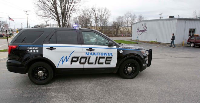 Manitowoc Police show up to drive through the Drive by and Wave parade at Ascend Services, Friday, May 1, 2020, in Manitowoc, Wis. Ascend Services serves individuals with exceptional abilities, and its participants have been at home since the state's safer-at-home order went into place.
