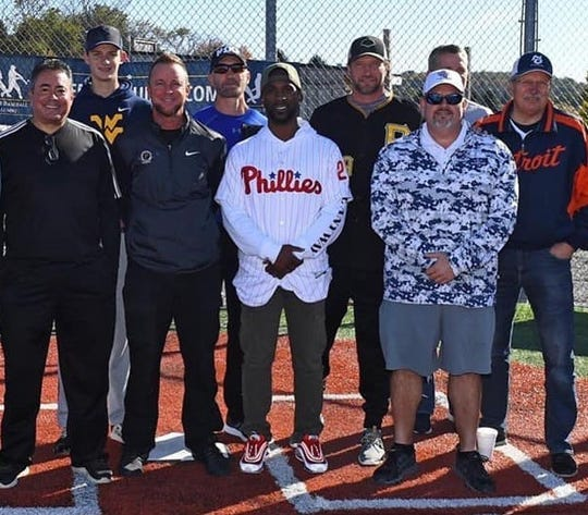 Ontario grad Marc Wilkins (white cap) joined several other ex-major leaguers and Philadelphia Phillies outfielder Andrew McCutchen to hold a clinic for 200 youngsters at the No Offseason Sports facility in Pennsylvania last fall. Pictured are (front row, left to right)  pitcher Omar Olivares, pitcher Chris Peters, McCutchen; (back row) pitcher Jason Grilli (Pirates jersey) and his dad, pitcher Steve Grilli (Detroit jacket).