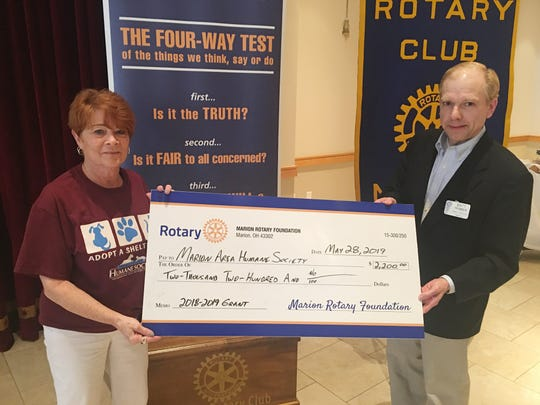 Rotary representative Matt Primmer presents a check to the Marion County Humane Society— an example of the many ways the club helps the community.