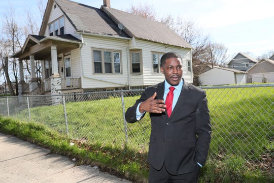 Incoming Milwaukee County Executive David Crowley talks in front of the now-vacant lot on North 23rd Street in Milwaukee, where up until 15 years ago the house he grew up in stood.