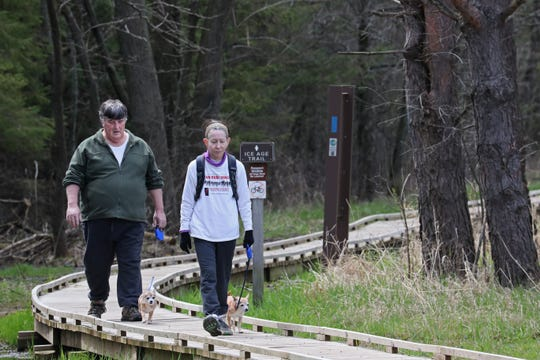 Bob Pecher walks his dog Indigo while his wife Lauren Pecher walks their dog Iris.  The couple is from Shorewood and was walking on part of the Ice Age Trail a Lapham Peak in the Southern Kettle Moraine State Forest near Delafield.