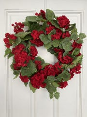 Spring-blooming geraniums are a bright addition to a seasonal wreath.