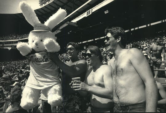 With two dramatic swings on a sunny Easter Sunday, the Milwaukee Brewers hopped into the record books with a 6-4 victory over the Texas Rangers, running their season-opening record to 12-0. The shirts were off (above) and the fans were out of their seats to cheer for the Brewers. Kevin Leist, 27, (with rabbit) his brother, Rick, 24, (center) and Tom Andersen, all of Manitowoc, brought the rabbit for good luck.