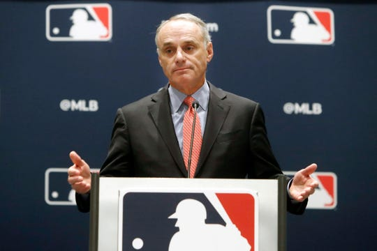 FILE - In this Nov. 21, 2019, file photo, baseball commissioner Rob Manfred speaks to the media at the owners meeting in Arlington, Texas. Major League Baseball is cutting the salary of senior staff by an average of 35% for this year and is guaranteeing paychecks to its full-time employees of its central office through May. Baseball Commissioner Rob Manfred made the announcement Tuesday, April 14, 2020.  (AP Photo/LM Otero, File) ORG XMIT: NYMV105