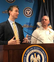 Louisiana Department of Health coronavirus expert Dr. Alex Billioux and Governor John Bel Edwards conduct a press conference on April 27.