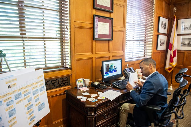 Mayor Steven Reed prepares for his virtual town hall meeting in his office at City Hall in Montgomery, Ala., on Friday, May 1, 2020.