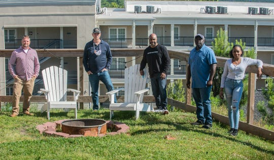 The grounds outside Goat Haus Biergarten will be expanded  for guests to enjoy. From left are Cameron Brown of Cameron & Sons Builders, Goat Haus owner James Weddle, Trent Edwards of the Montgomery Area Chamber of Commerce, brewer Carpage Robinson, and chef Erin Wallace on Thursday, April 30, 2020.