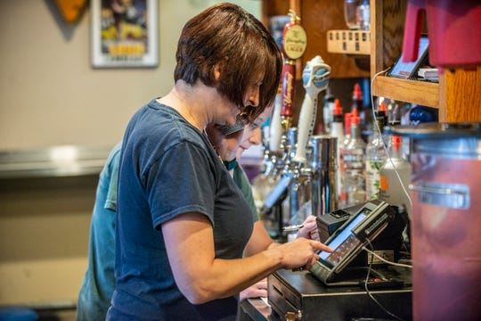 Jessica Sommer Conner, owner and manager at Sommer's Place on Vaughn Road, takes a to-go order on Thursday, April 30, 2020.