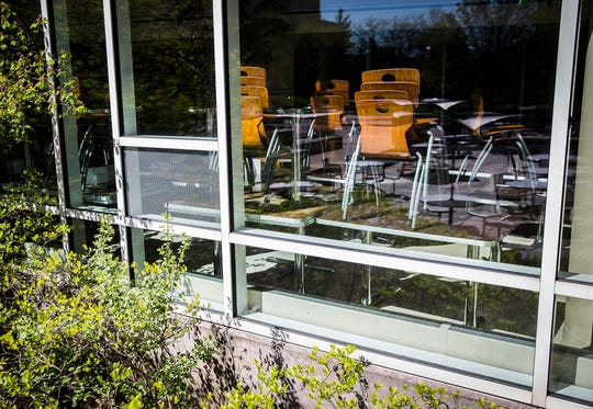 Chairs are lined up against a window at the Atrium dining area on Ball State Campus Friday, May 1, 2020.