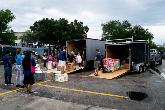 Volunteers donate supplies for eight families, including diapers, sanitary products, and cleaning products, at Redlands Christian Migrant Association in Immokalee on Thursday, April 30, 2020.