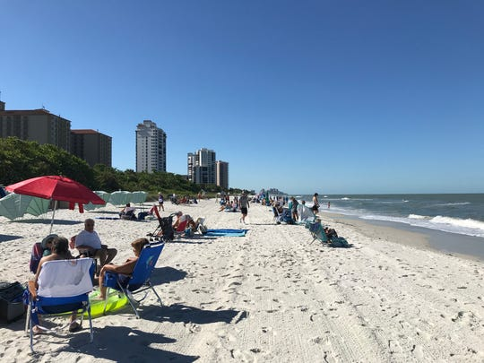 Beachgoers enjoy the weather at Vanderbilt Beach in North Naples on Friday, May 1, 2020.