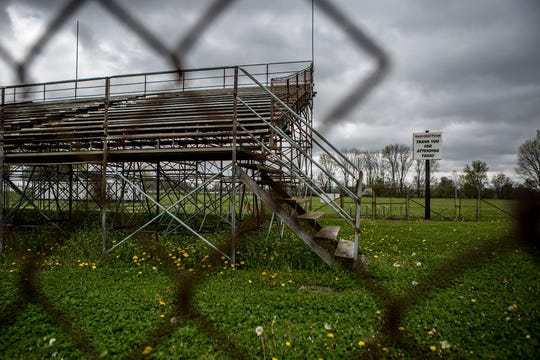 A sign thanking spectators at National Trails Raceway for attending raceways stands surrounded by empty stands. National Trails will most likely be closed for the season due to the pandemic and social distancing.