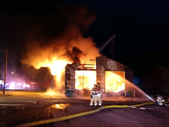 Newark Fire personnel fight a blaze at a building on McKinley Avenue on Thursday night.