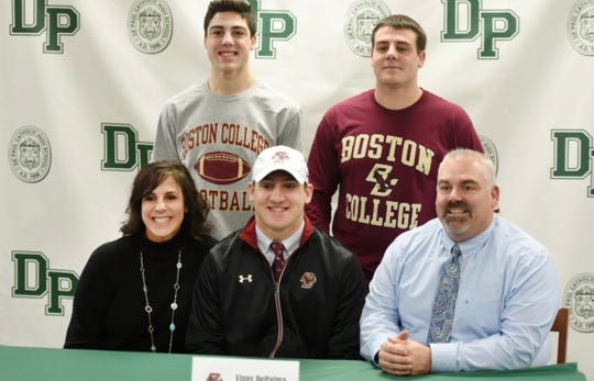 Vinny DePalma, seated middle, poses with his parents, Michele DePalma and John DePaul, (both seated) and brothers Anthony DePalma (standing left) and Nick DePalma. Vinny DePalma, of DePaul, signed with Boston College in accepting  a football scholarship.