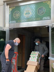 Volunteers assemble food and hygiene packages at the North Hudson Islamic Educational Center in Union City.