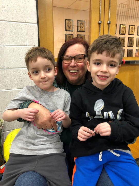 Lois Jasper poses with two of her grandsons, Jack and Charlie, at a Pascack Valley game.