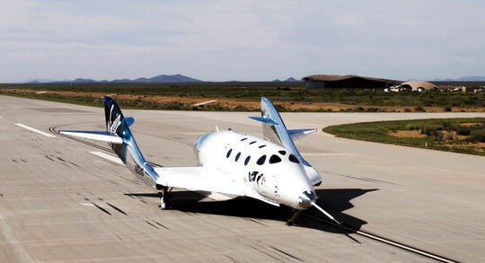 SpaceShipTwo Unity completes a runway landing at Spaceport America, in New Mexico on Friday, May 1, 2020. Virgin Galactic's spaceship VSS Unity has landed in the New Mexico desert after its first glide flight from Spaceport America. The company announced Friday's flight on social media, sharing photos of the spaceship.