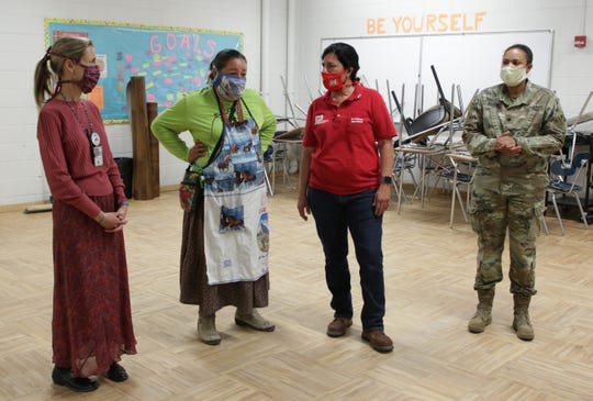 Navajo Nation Council Delegate Amber Kanazbah Crotty, second from left, talks with Amanda Velasquez, project manager for the U.S. Army Corps of Engineers Albuquerque District, during a tour of the alternate care site on April 29 at Northwest High School in Shiprock.