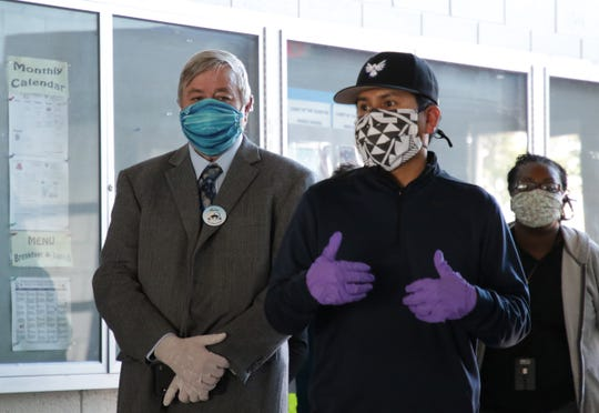 Shiprock Associated Schools Inc. Executive Director Rick Edwards, left, and SASI School Board President Pete Ken Atcitty, center, were among officials to tour the alternate care site on April 29 at Northwest High School in Shiprock.